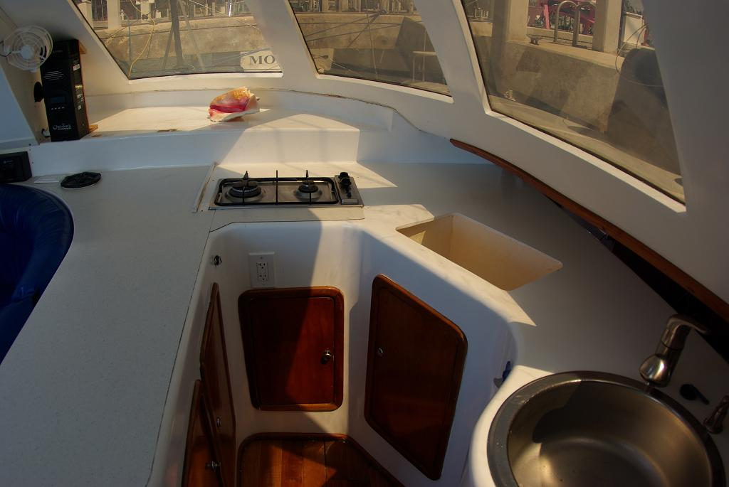 The galley has lots of counter space, both a wash sink and a drain sink, and lots of storage